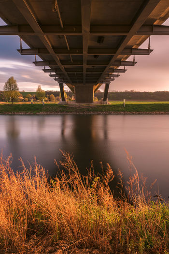_---_the bridge_---_ River Connection No People Architecture Outdoors Built Structure Sunset Nature Bridge EyeEm Best Shots EyeEm Nature Lover Eyemphotography Brücke The Architect - 2017 EyeEm Awards Wasser Motion Flüsse In Deutschland Sonnenuntergang EyeEmNewHere Landscape_Collection Landscape Tom Zander Art Is Everywhere Landscape_photography Eye4photography  The Architect - 2017 EyeEm Awards