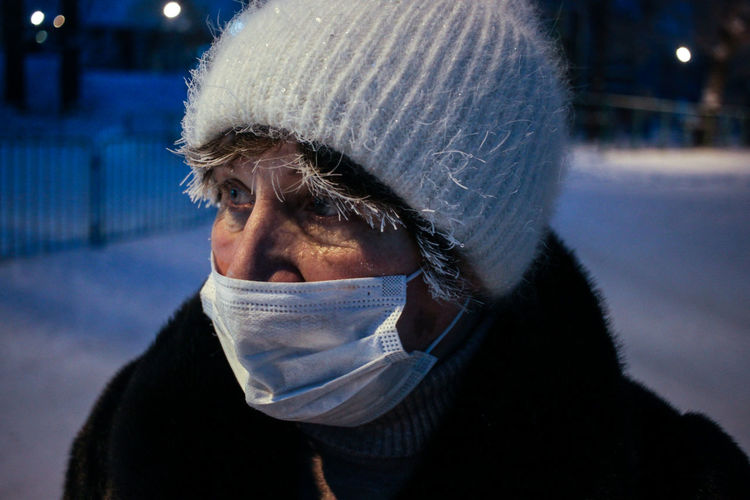 Close-up if senior man wearing mask standing outdoors