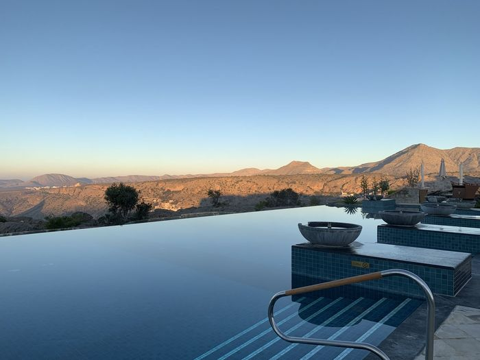 Scenic view of swimming pool against clear sky