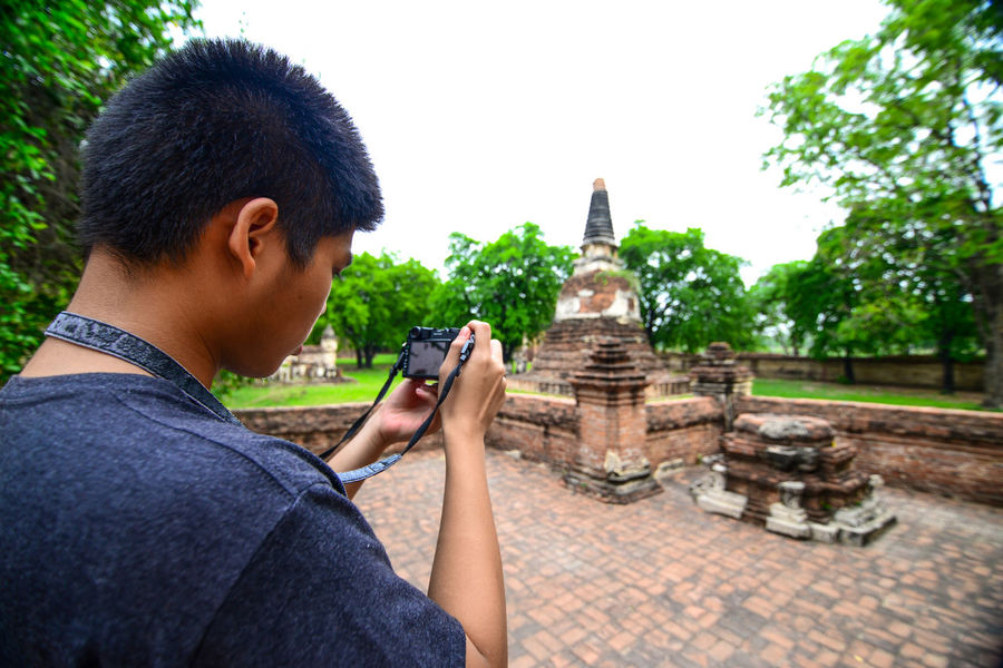 Visit at Ayutthaya old temple One Person Architecture Holding Young Adult Built Structure Religion Place Of Worship Belief Young Men Building Exterior Technology Casual Clothing Spirituality Portrait Day Men Tourism Travel Destinations Wireless Technology Outdoors Old Temple Beautiful Temple Nice Temple Nice Place