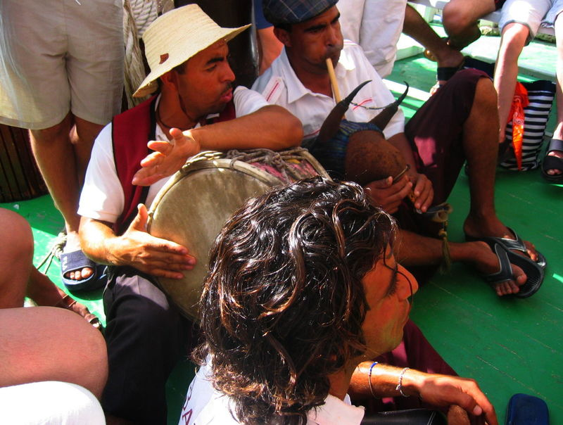 Music Sitting On The Floor Tunisia July 2005 Musicians Near Djerba Outdoors Playing Ship Deck Traditional Instruments