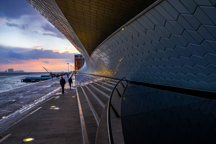 Architecture MAAT Museum Maat, Portugal, Belem Architecture Bridge Bridge - Man Made Structure Building Exterior Built Structure City Cloud - Sky Connection Incidental People Lifestyles Maat Maat - Museum Men Nature One Person Outdoors Railing Real People Sky Sunset Transportation Water