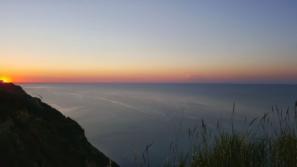 Colour Of Life Hanging Out Taking Photos Check This Out Hello World Hi! Relaxing Enjoying Life Hidden Gems  Sunset_collection Red Sky Blue Sea Cliff View Italy Sun Afternoon Sky Calm Sea High View Horizon Over Water A Bird's Eye View