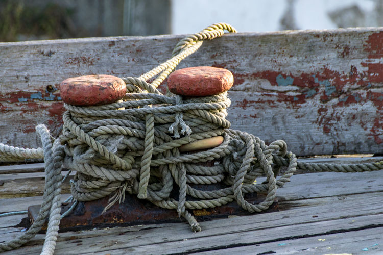 Close-Up Of Ropes Tied On Bollard