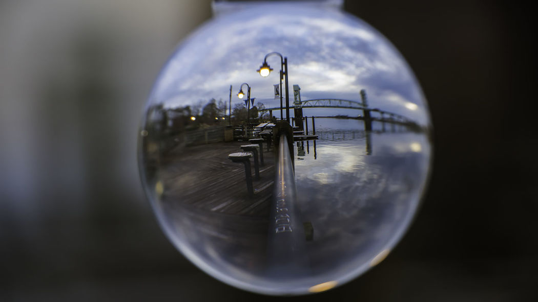playing around with a lensball Nikond750 Riverwalk Downtown Tamrom28300 ThroughMyLens Wilmington NC WithMyTamron Artsy Photography Capefearmemoralbridge Close-up Lensball No People Outdoor Photography Portcity Reflection Sunset #sun #clouds #skylovers #sky #nature #beautifulinnature #naturalbeauty #photography #landscape Sunsets Tamronusa Turntheworldupsidedown Waterfront