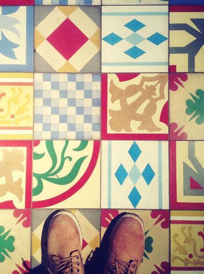 High Angle View Of Shoes On Patterned Floor