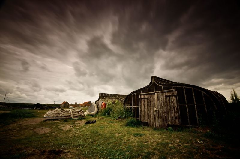 Wooden sheds with gloomy sky