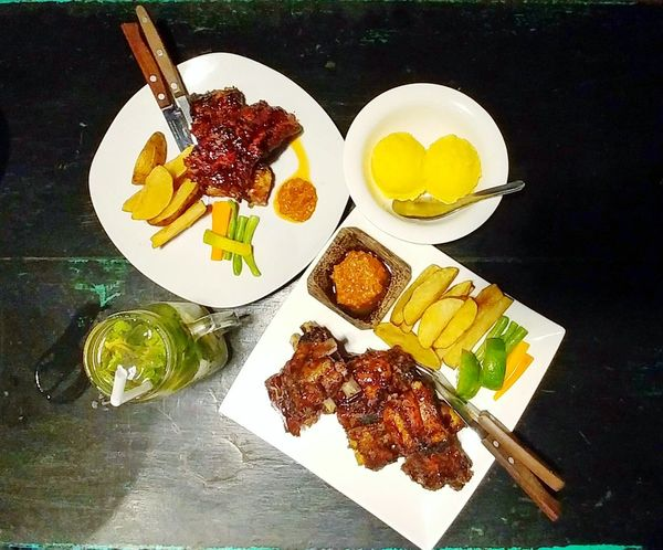 Ready-to-eat Serving Size High Angle View Meal Served Indulgence Table Food And Drink Food Freshness Plate Dinner For Two Bbq Ribs Pork Ribs Musteat Recomended Eating Outside