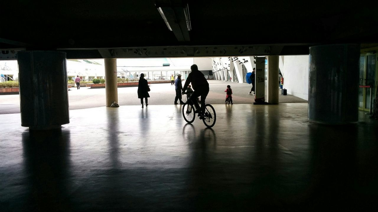 bicycle, transportation, built structure, men, indoors, day, architecture, sunlight, real people, one person, people