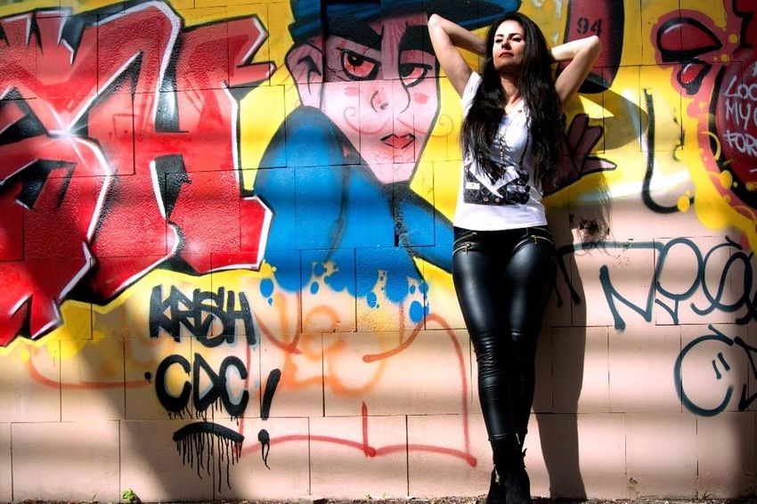 Graffiti Street Art Spray Paint Only Women Multi Colored One Woman Only One Person Young Adult Adult Adults Only Front View Young Women People Portrait Arts Culture And Entertainment Artist Youth Culture One Young Woman Only Standing Lifestyles Model Tough Girl Street Art/Graffiti