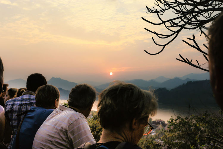 sunset at luangprabang,Loas Adult Beauty In Nature Cloud - Sky Headshot Lifestyles Mountain Nature Outdoors People Real People Rear View Sky Sunset