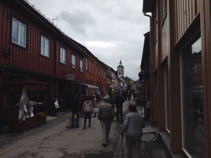 On the street in Røros, Norway. Norway Røros Street Church House People Walking Around Walking Colors