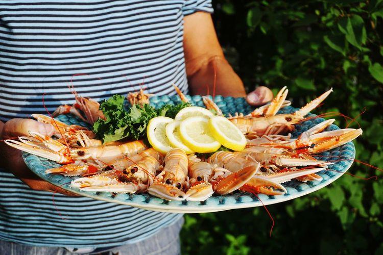 Man serving crayfish at a garden party