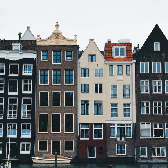 View of apartment buildings on amsterdam canal