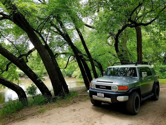 Toyota FJ Automobile Transportation FJ Cruiser No People Trees Leaning Trees SUV Riverside River View Land Vehicle Tree Trunk Treelined 4x4 Sports Utility Vehicle Off-road Vehicle Parking
