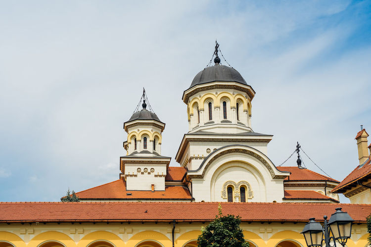 Romanian Church Built Structure Architecture Building Exterior Religion Belief Low Angle View Spirituality Place Of Worship Sky Building Day Nature Travel Destinations Travel Traveling Church Church Architecture Tower Sculpture Landmark Cloud - Sky Medieval Cathedral Catholicism Orthodox Church