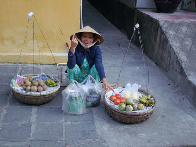 Fruit Vendor Choice Composition Culture Food Freshness Front View Fruit Full Frame Healthy Eating Hoi An Lifestyles Looking At Camera Making A Living No Incidental People Outdoor Photography Portrait Sitting Smiling Street Street Vendor Traditional Traditional Clothing Vegetable Vietnam Young Woman