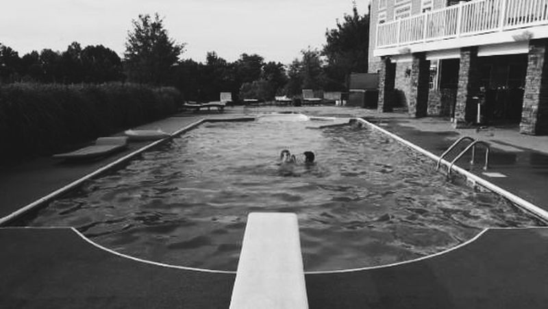Water Sport Leisure Activity Day People Outdoors Adult Real People Swimming Tree Sky One Man Only Black And White Photography Black And White Black&white Summer Pool Poolside Kubrick Kubrick Inspired Kubrikian Vintage Phoneography Grunge Architecture