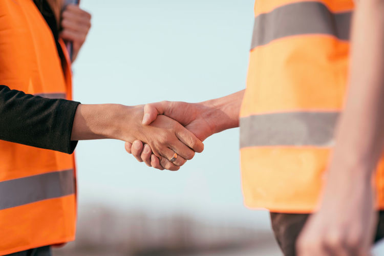 Close-up of engineers shaking hands