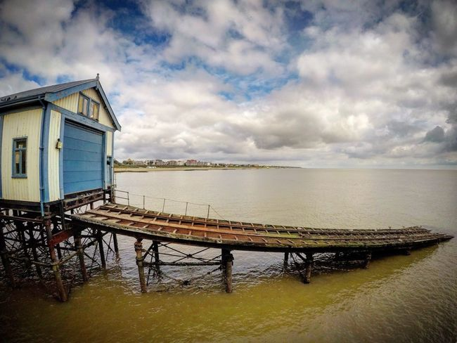 Cloud - Sky Sky Built Structure Water Architecture Sea Tranquility Nature No People Tranquil Scene Building Exterior Outdoors Day Scenics Beauty In Nature Horizon Over Water Lifeboat Station... Lifeboat