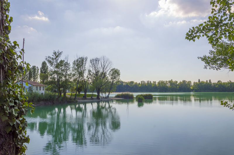 Forlì, Italy, a small but beautiful lake really close to the city Beauty In Nature Cloud - Sky Day Growth Idyllic Lake Nature No People Non-urban Scene Outdoors Plant Reflection Scenics - Nature Sky Tranquil Scene Tranquility Tree Water Waterfront