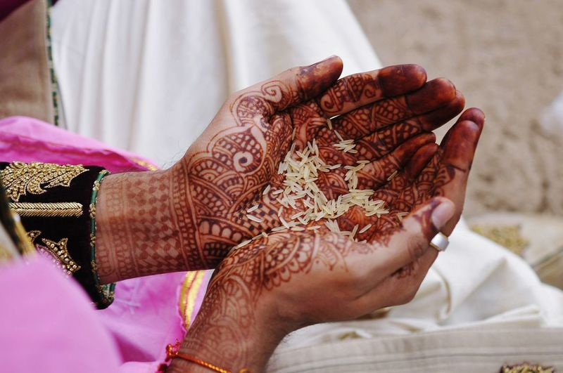 Midsection Of Woman Holding Rice In Palm Of Hands
