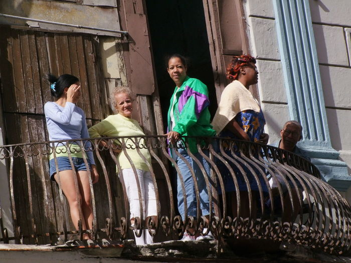 Cubans watching the world go by! Balcony Casual Clothing Composition Cuba Cubans Family Friendship Full Frame Full Length Havana Leisure Activity Lifestyles Looking At Camera Low Angle View No Incidental People Outdoor Photography Portrait Relaxing Side By Side Smiling Sunlight And Shadow Tourist Attraction  Tourist Destination Women