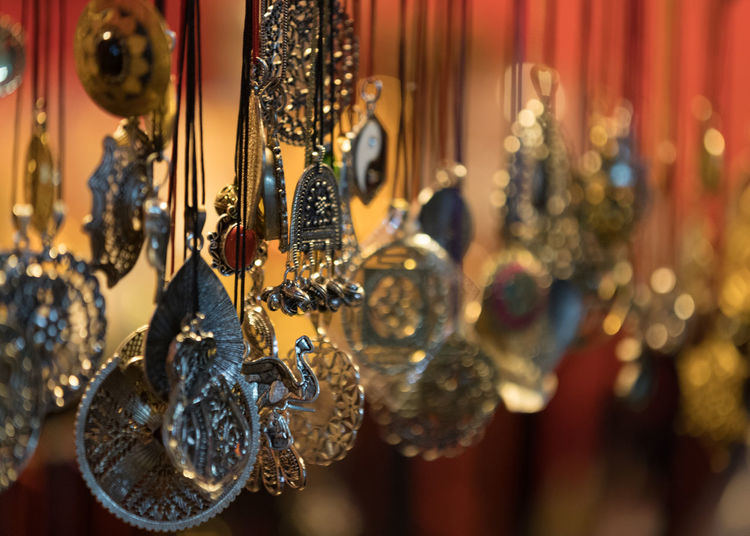 Close-up of decorations hanging in store for sale