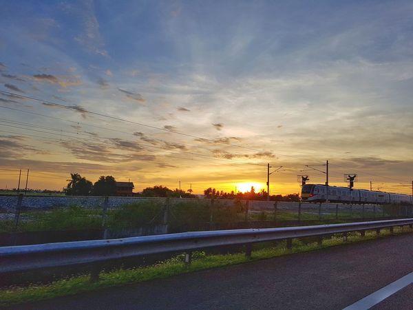 Roadside view during sunset. Railroad Track Rail Transportation Roadside Sunset Sky Cloud - Sky Silhouette Dramatic Sky Atmospheric Mood Orange Color Tranquil Scene Scenics
