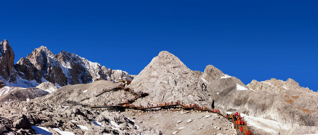Jade Dragon Snow Mountain,Mount Yulong or Yulong Snow Mountain at Lijiang,Yunnan province,China. Beauty In Nature Blue Clear Sky Day Mountain Mountain Range Nature No People Outdoors Rock - Object Scenics Sky Sunlight