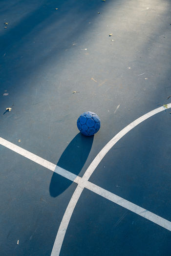 High angle view of soccer ball on road