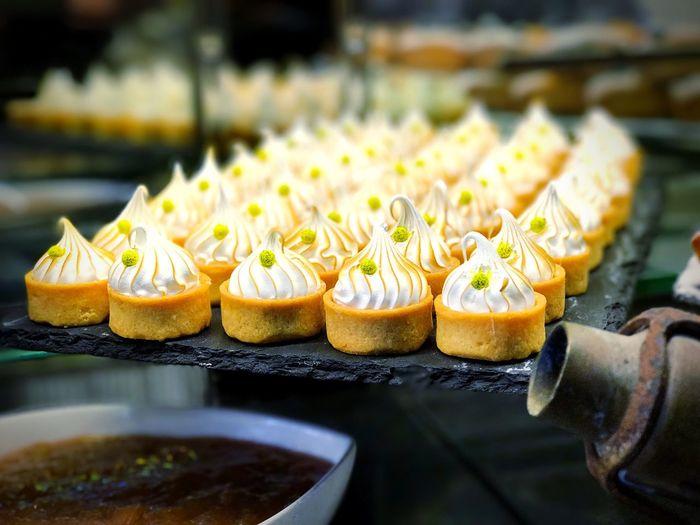 Sweet food arranged on granite plate