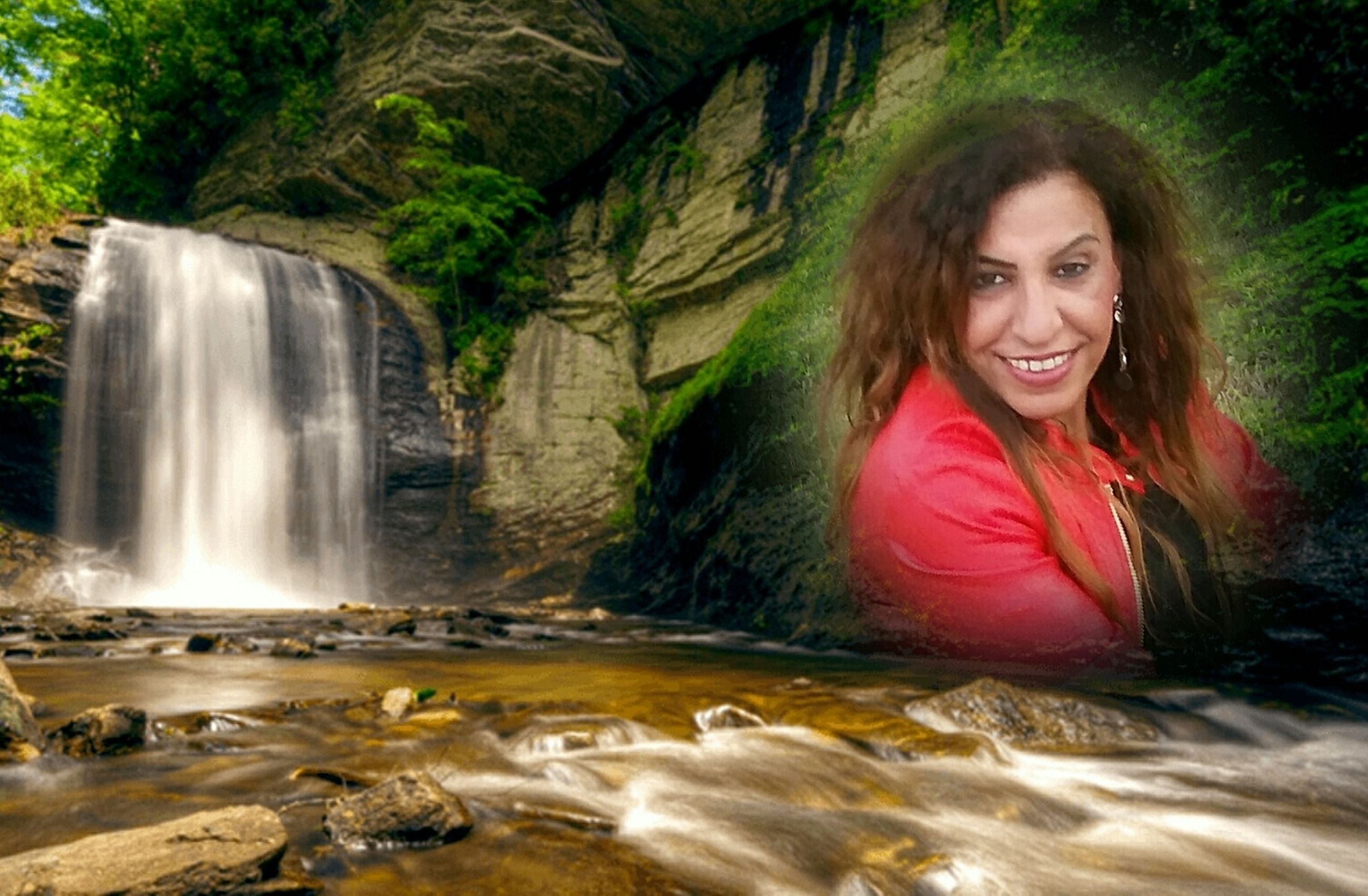 water, waterfall, smiling, rock - object, happiness, beauty, river, motion, beautiful woman, portrait, adults only, one person, one woman only, beauty in nature, nature, adult, young adult, adventure, people, only women, looking at camera, vacations, long exposure, outdoors, beautiful people, women, swimming, cheerful, day, one young woman only, young women, tree