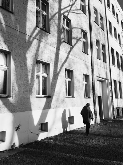 Berlin Mitte Architecture Built Structure Building Exterior Window Day Shadow Sunlight Outdoors Real People People City Adult VSCO Vscocam Streetphotography Blackandwhite Shadows & Lights