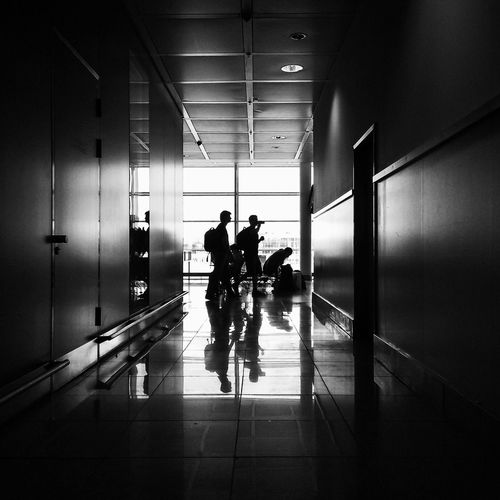 Silhouette of man in corridor