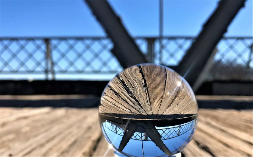 Close-up of crystal ball on boardwalk