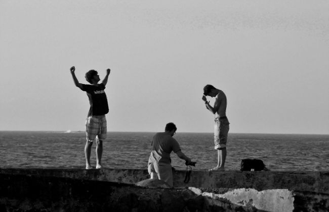 Boys Casual Clothing Clear Sky Enjoyment Friendship Full Length Fun Horizon Over Water Leisure Activity Lifestyles Mid-air Sea Seascape Three Of A Kind Standing Togetherness Tranquil Scene Black & White Water People And Places Faja Grande Resort Flores Island Azores Islands