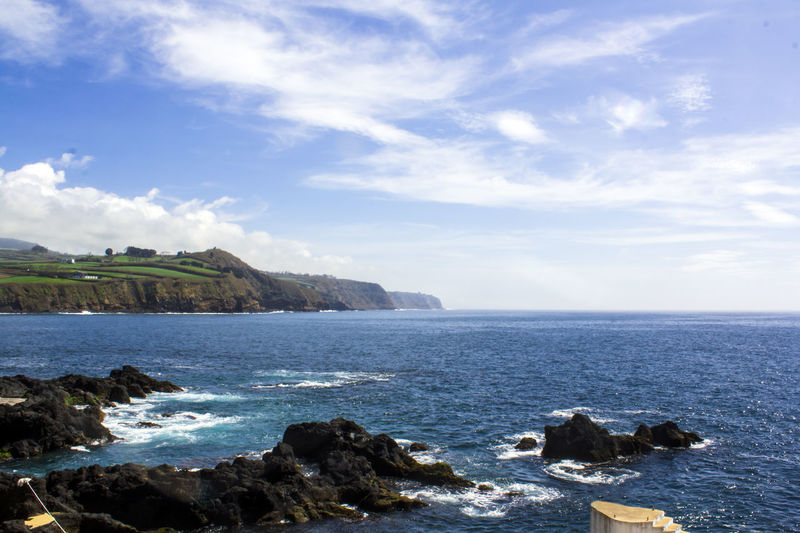 Coastline landscape with Blue Ocean and land with green fields Atlantic Ocean Azores Blue Color Coastline Scenic Azores, S. Miguel Beauty In Nature Day Horizon Over Water Idyllic Island Land Landscape Natural Pool Nature No People Ocean Outdoors Rocky Coastline Scenics - Nature Sea Seascape Shore Vibrant Water