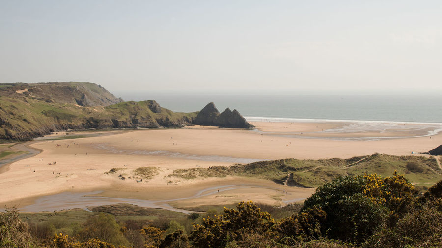 Three Cliffs Bay Sand Dune Water Sea Clear Sky Beach Full Length Sand Wave Tree Sky