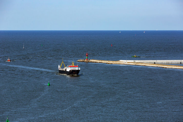 Baltic Sea Harbor Beauty In Nature Blue Clear Sky Day Horizon Horizon Over Water Mode Of Transportation Nature Nautical Vessel No People Outdoors Scenics - Nature Sea Ship Sky Tranquil Scene Transportation Travel Water Waterfront