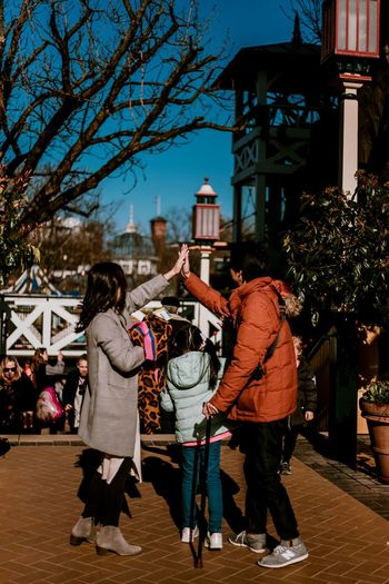 Family Family With One Child High Five! High Five Love Family Portrait Amusement Park Fairground Tivoli Back View Portrait Portrait Photography Real People Happiness Full Length Togetherness Happiness Christmas Decoration