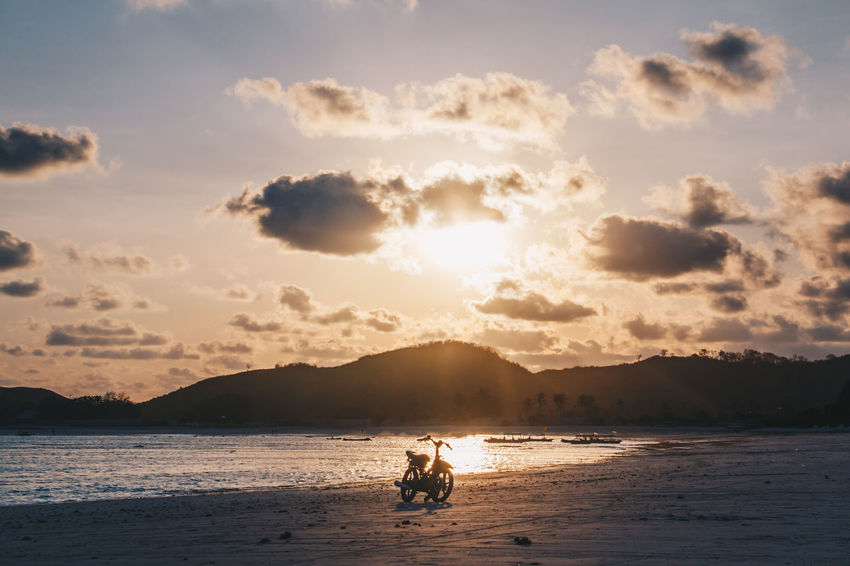 Beach Beauty In Nature Cloud - Sky Day Leisure Activity Lifestyles Men Mountain Nature Nautical Vessel Outdoors Real People Sand Scenics Sea Sitting Sky Sun Sunlight Sunset Togetherness Two People Vacations Water Young Adult Be. Ready.