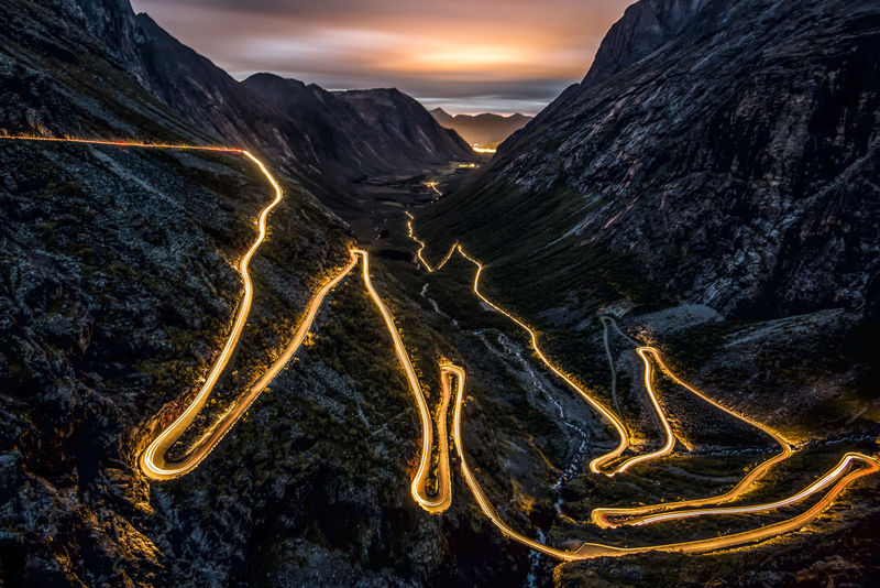 Trollstigen Night LTE Norway Beauty In Nature Illuminated Landscape Lte Mountain Mountain Range Mountain Road Nature Night No People Outdoors Scenics Sky Sunset Tranquil Scene Tranquility Trollstigen Winding Road