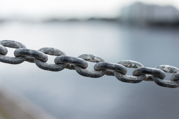 Alloy Barrier Boundary Chain Chains Close-up Connection Day Durability Fence Focus On Foreground Iron Iron - Metal Metal No People Outdoors Protection Safety Security Selective Focus Steel Strength Water