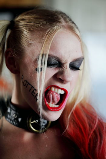 Close-up of young woman making a face during halloween cosplay