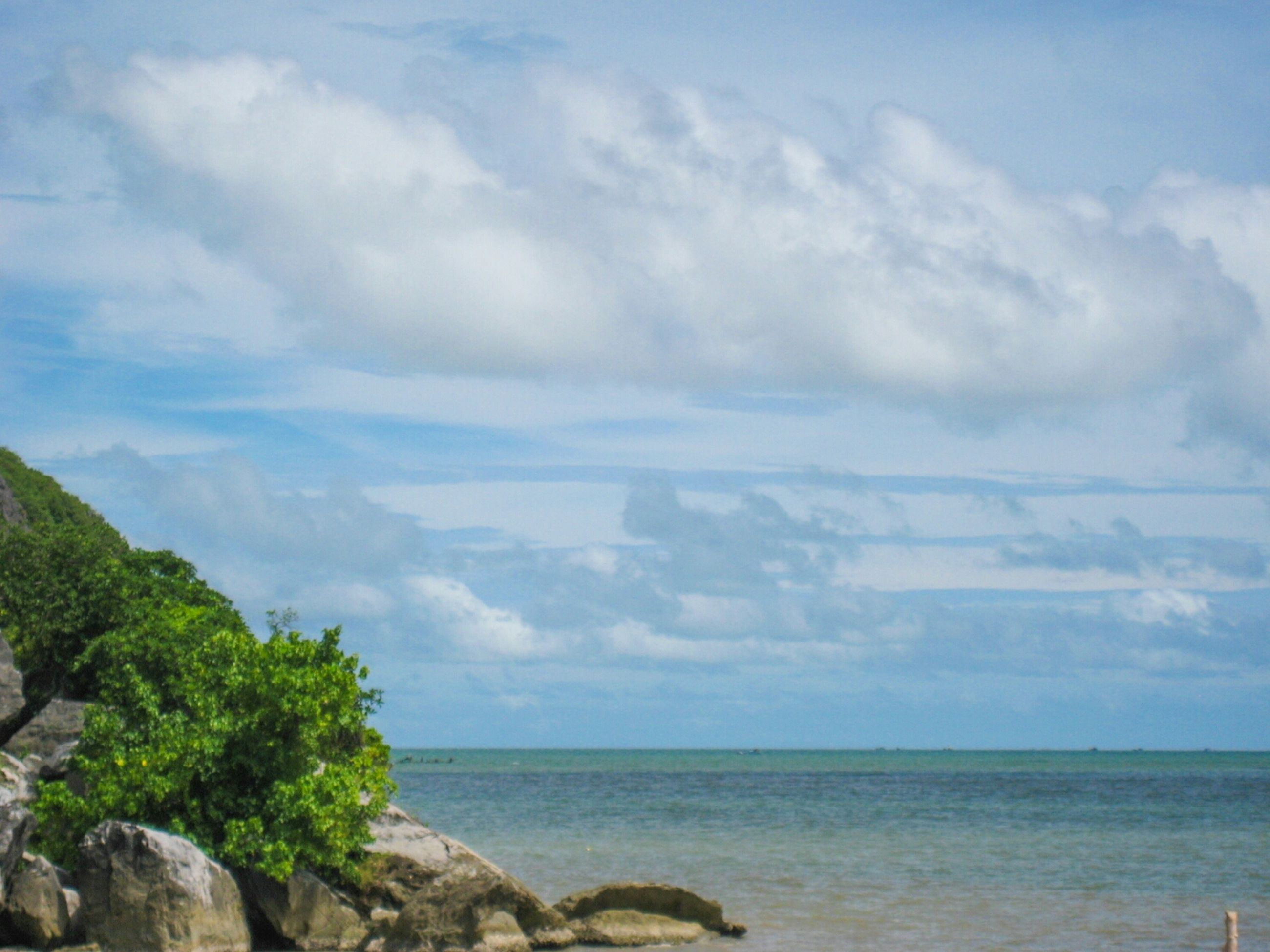sea, horizon over water, sky, water, scenics, tranquil scene, beauty in nature, tranquility, cloud - sky, nature, rock - object, cloudy, cloud, idyllic, day, outdoors, blue, non-urban scene, no people, remote