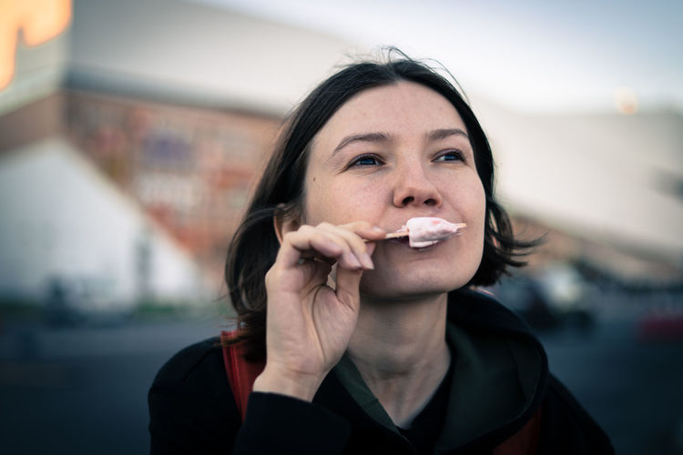 Close-Up Of Mid Adult Woman Eating Ice Cream