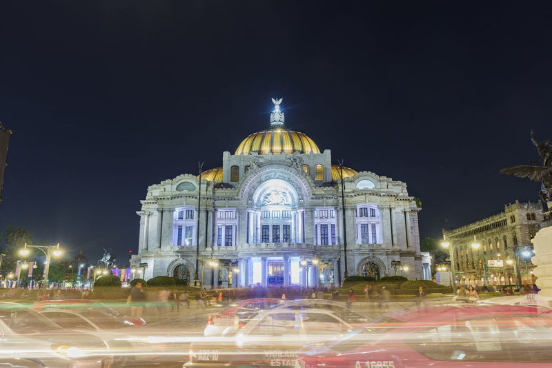 Night view of the Palacio de Bellas Artes in Mexico Busy Cathedral Of Art Lights Mexico City MobilityInCDMX Night Photography Rhythm Car Trails Cdmx Mobility Night Palace Of Fine Arts Palacio De Bellas Artes  Mobility In Mega Cities