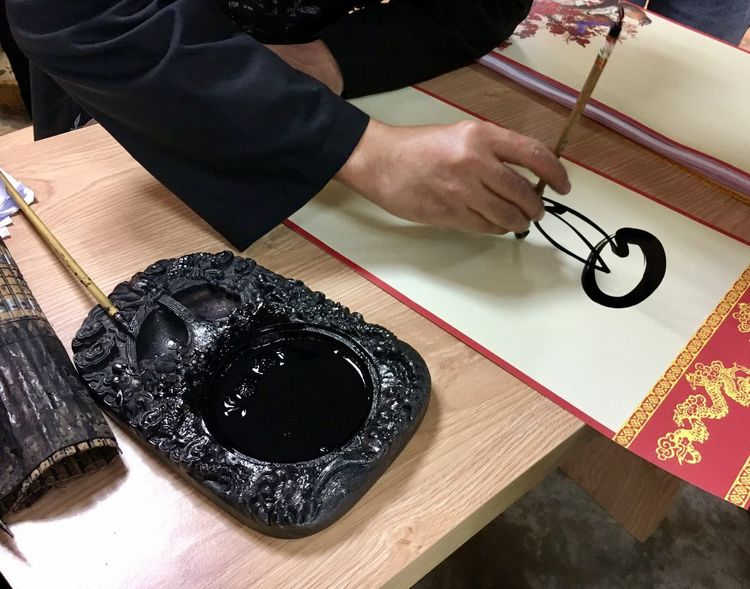 Calligraphy in Lunar New Year Lunar New Year New Year Cultures Vietnam Tradition Calligraphy Indoors  High Angle View Table Real People One Person Human Hand Human Body Part Close-up People