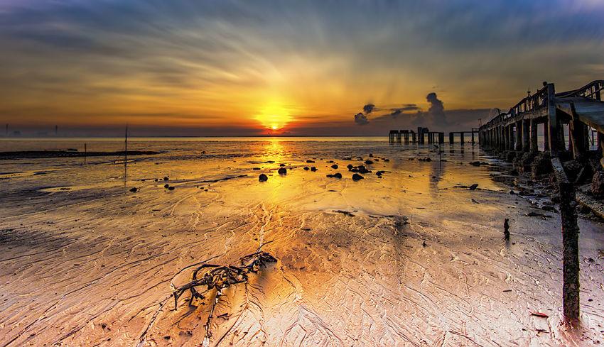 Sunrise at Tanjung Piai Pontian Johor Malaysia Beach Beauty In Nature Cloud - Sky Day Detail Horizon Over Water Johor Bahru No People Outdoors Reflection Sand Sea Sky Sun Sunrise Sunrise N Sunsets Worldwide  Sunrise_sunsets_aroundworld Tanjung Piai Water